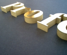 Side view of 3-D lettering 12 inch thick with brushed gold faces